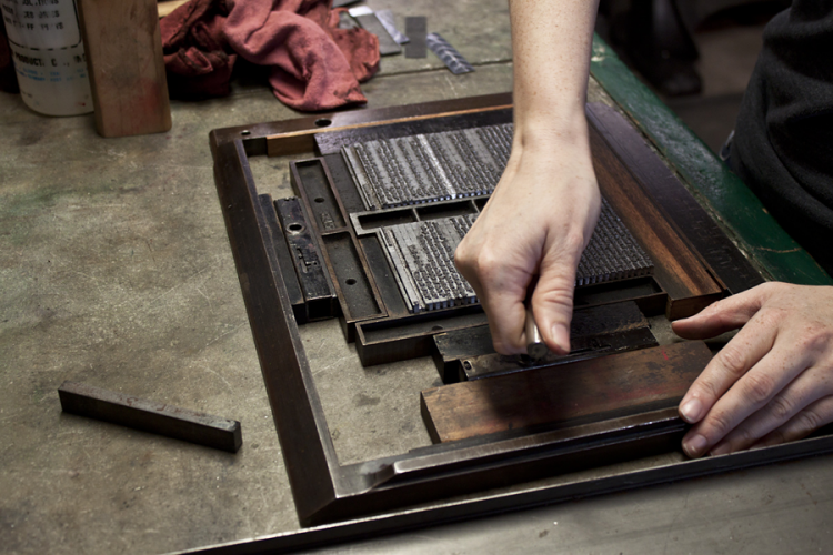 A letterpress technician preparing to print a book